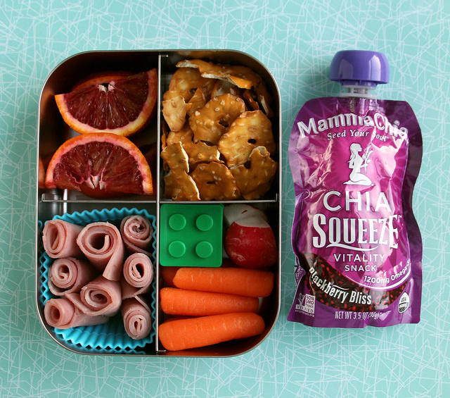 Bento box with blood oranges and chia pouch
