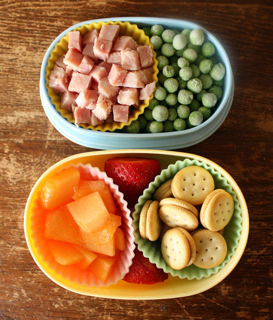 Cut ham into cubes for kids's lunches